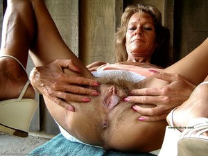 Strap-on porn photo with mature women